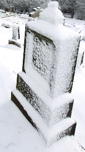Snow-covered Tombstone